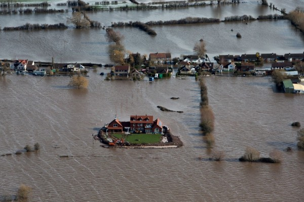 UK House surrounded by floods