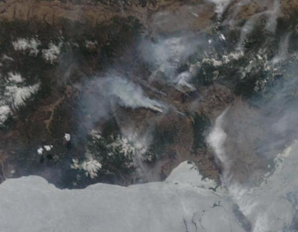 Russian wildfire burning on the shores of still frozen Lake Baikal April 23 2014