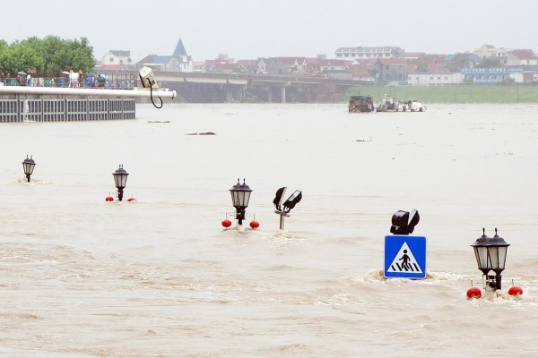 Traffic Signs Submerged along a River in Lanxi