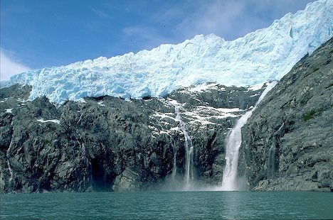 Alaska. Prince William Sound, waterfall flows from under Blackstone Glacier.