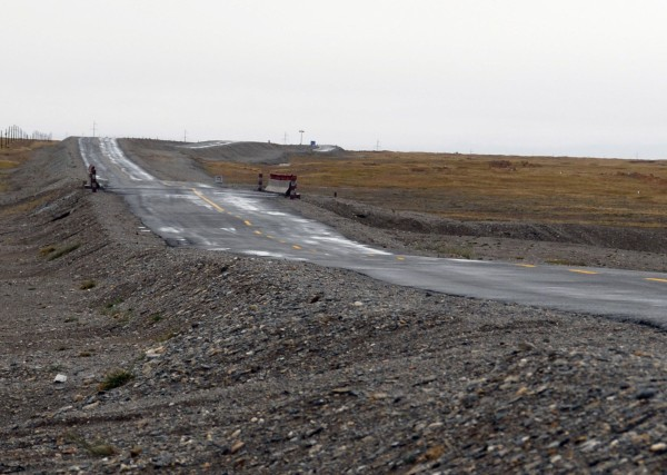 Permafrost thaw causes roads to crack sag and buckle